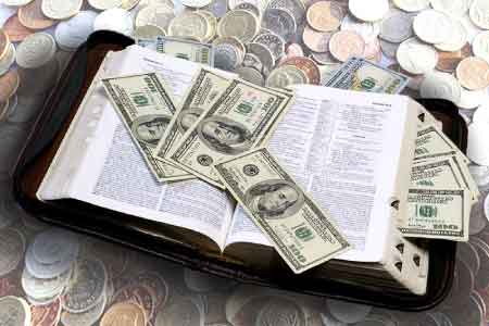 image of a Bible surrounded by money