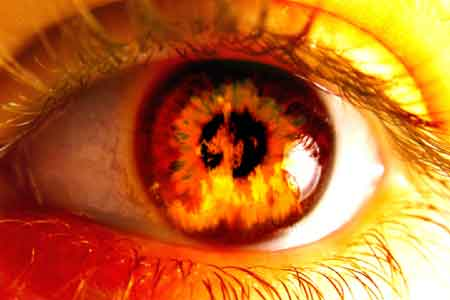 eye of a person on fire for God