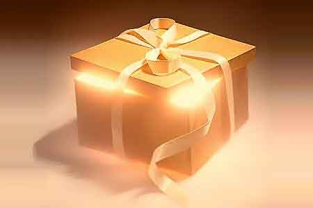 image of a gift box with bright light shining out of it depicting spiritual gifts