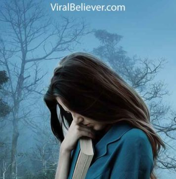 image of a depressed woman holding a Bible